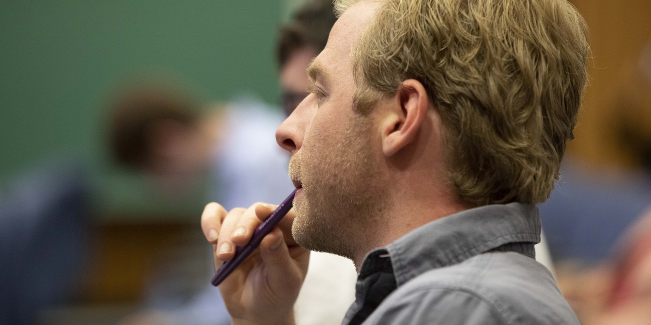 A journalist listening to a presentation at a One-Day Law School for Journalists™ at the University of Pittsburgh School of Law