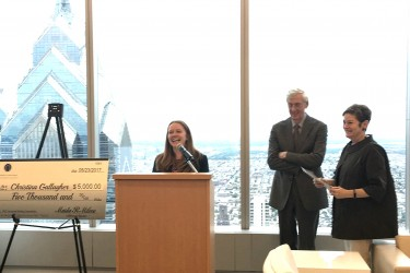 Christina Gallagher, winner of PMC's 2017 Law Student Writing Competition, standing at a podium with Robert Heim, PMC's Chair, and Maida Milone, PMC's Presidnet & CEO